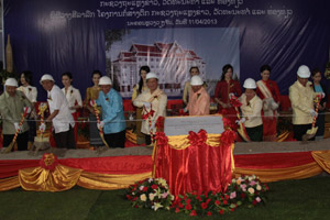 Prof. Dr Bosengkham Vongdara (fifth left) and senior officials from the Ministry of Information, Culture and Tourism, company representatives and invited guests take part in a groundbreaking ceremony.