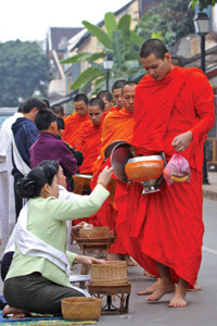 Almsgiving is among the highlights of a visit to the World Heritage Site of Luang Prabang.
