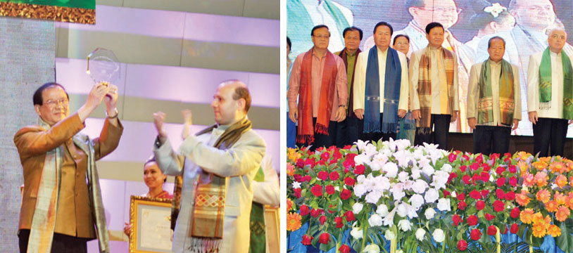 Minister of Information, Culture and Tourism Prof. Dr. Bosengkham Vongdara, left, celebrates the World Best Tourist Destination Award for