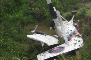 The Twin Otter aircraft after it crashed in Huaphan province. --Photo Misa Phomvongsa